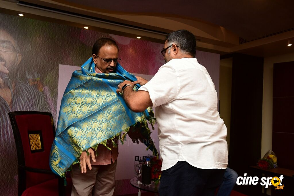 MJ Shriram presenting SP Bala Subrahmanyam with a shawl
